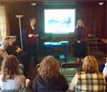 Photo of bestselling author Kathleen Ernst and curator Tamara Funk speaking at Chloe Ellefson mystery tour and talk at Pendarvis Historic Site in Mineral Point Wisconsin 12 October 2019.