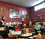 Photo of betselling author Kathleen Ernst talking about her Chloe Ellefson mysteries 20 October 2019 at Reader's Realm in Montello WI.
