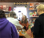 Bestselling author Kathleen Ernst signing copies of her 9th Chloe Ellefson mystery, The Lacemaker's Secret, on 13 Otober 2018 at Old World Wisconsin. Photo by Mr. Ernst.