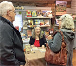 Larry & Linda Dokken chat with bestselling author Kathleen Ernst as she signs their copy of Mining For Justice, the 8th book in her Chloe Ellefson mystery series, on October 14, 2017, at Old World Wisconsin..