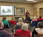 Crowd at bestselling author Kathleen Ernst Chloe Ellefson mystery series program on October 11, 2017 at the Ruth Culver Community Library, Prairie du Sac, WI.