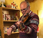 Sid Boersma playing his Hardanger fiddle 14 December 2019 at Nordic Nook in Stoughton WI
