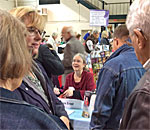 Photo of bestselling author Kathleen Ernst signing books at the 2018 Sterling North Book Festival in Edgerton Wisconsin.