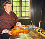 Musician and Hardanger Fiddle at Norsk Folk Museum in Oslo Norway