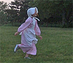Photo of a little girl dressed as Laura Ingalls Wilder taken by author Kathleen Ernst at Walnut Grove, MN.