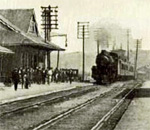 Black and white photo of a passenger train pulling into Hastings MN railroad station circa 1920.
