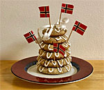 Photo of a mini Kransekake Norwegian wreath cake made by bestselling author Kathleen Ernst.