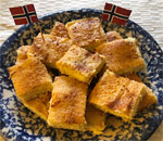 Plate of Norwegan Rommergrot bars made by bestselling author Kathleen Ernst.