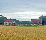 The German Schultz Farm at Old World Wisconsin, featured in the Chloe Ellefson mystery A Memory of Muskets by bestselling author Kathleen Ernst. Photo circa 2015 by the author.