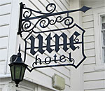 Photo of Utne Hotel sign in Utne Norway taken by bestselling author Kathleen Ernst.