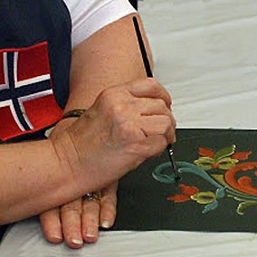 "Marit ""All Things Norwegian"" Kallerud, is a world class rosemaling painter who has taken and taught Norwegian 'rose painting' classes at Vesterheim for over fifteen years."