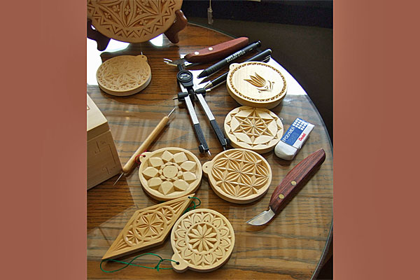 <strong>Norwegian chip carving tools and examples.</strong> Roelke takes a class at Vesterheim in this style of carving. (Chip carved ornaments by Ellen Macdonald. Photo by author.)
