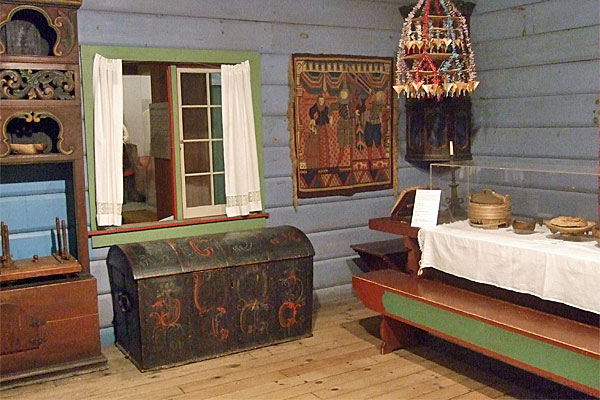 <strong>Rosemaled trunk in Vesterheim's Norwegian House exhibit.</strong> Chloe makes a startling discovery when she opens this trunk. (Vesterheim Norwegian-American Museum. Photo by author.)