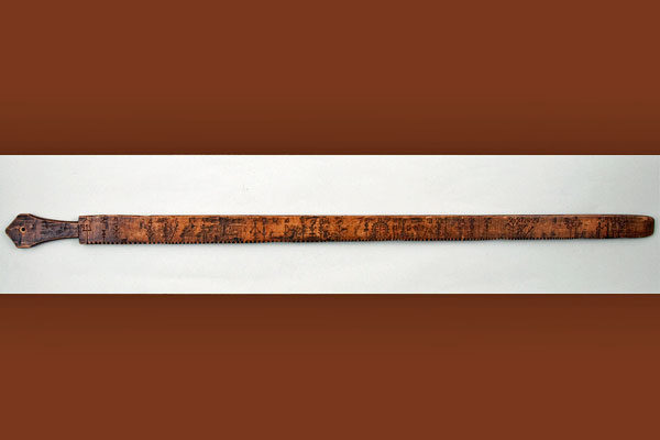 <strong><em>Primstav</em> - Norwegian wooden calendar stick.</strong> Hand carved calendar sticks like this once helped rural Norwegians keep track of important dates. (Courtesy Vesterheim Norwegian-American Museum.)