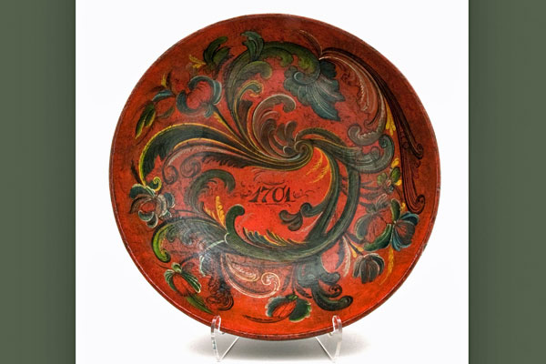 <strong>Rosemaled bowl painted in the Telemark style.</strong> Chloe takes a beginning Telemark rosemaling class at Vesterheim. This piece was produced by someone with advanced skills. (Courtesy Vesterheim Norwegian-American Museum.)