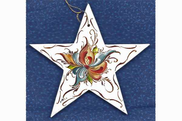 <strong>Rosemaled wooden christmas ornament.</strong> As a beginning student Chloe can only dream of painting such fine work. (Rosemaled star by Norma Wangsness. Photo by author.)