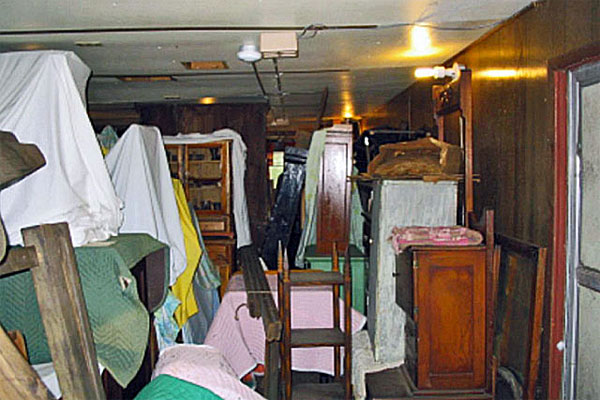 When Chloe started at Old World in 1982, some collections were stored in two old trailers. Note: Old World has had a proper modern storage facility for many years. (Photo courtesy Old World Wisconsin.)