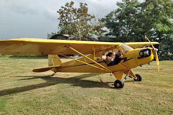 "Roelke, who's already earned a pilot's license, dreams of buying a ""sweet little"" Piper J-3 Cub he sees at the Palmyra, WI, airport. (Photo from BarnStormers.com.)"
