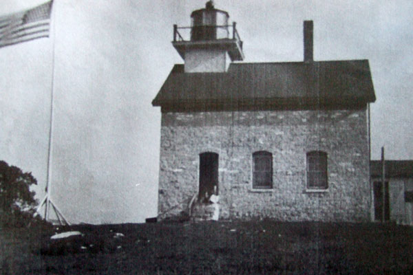 <strong>Pottawatomie Lighthouse Then.</strong> This image is believed to show Emily Betts and several of her children at the front door of the lighthouse about 1880. (US National Archives and Records Administration photo.)