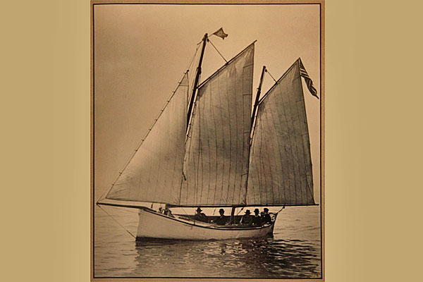 <strong>Mackinaw Boat.</strong> These 18-24 foot wooden work boats could be sailed when there was wind or rowed when there wasn't.  Mackinaws were widely used on the Great Lakes during the 1800s.  Anders Anderson and Ragna's brothers fished from a Mackinaw. (Michigan Maritime Museum. Photo by Kenneth Bowen.)